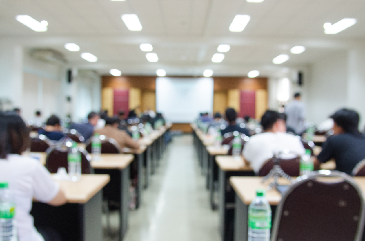Abstract blur background of conference hall or seminar room, shallow depth of focus.